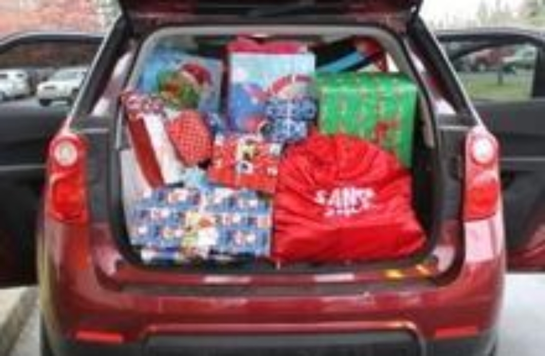 A red car filled with presents